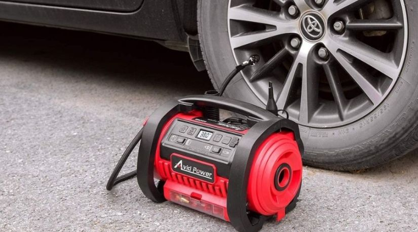 An image of one of the best cordless air compressor in use to inflate a car tire