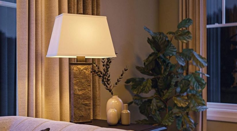 A picture of Kenroy Home Rustic Table Lamp ,29 Inch Height, 15 Inch Width, 9.5 Inch Length with Natural Slate Finish being,one of the brightest unit among the best cordless floor lamp used in a reading table