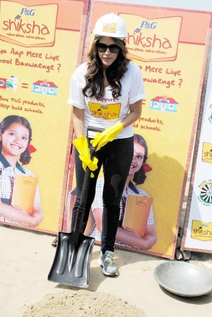 Neha Dhupia seen  at P&G Shiksha school to help build playground for children