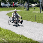 Kenny-riding-hand-cycle-example-of-trail-training-program