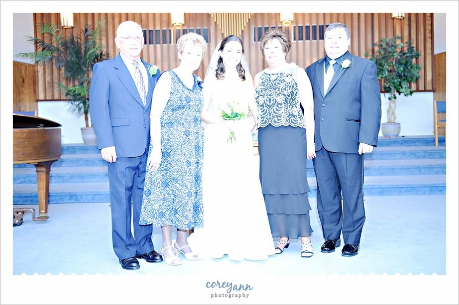 guest flash during formal portrait of family during wedding