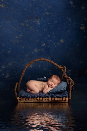 newborn floating boat dreaming