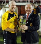 Ger O'Brien, captain of Crescent Athletic receiving the St. Michael's Cup from Richard Browne, (Cork AUL) following their victory over Knocknaheeney Celtic in the St. Michael's Cup final in Turners Cross on 12 April 2016