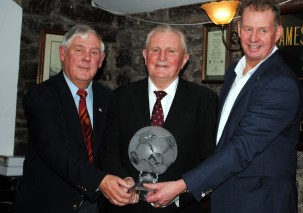 """Ted O'Mahony presenting Michael """"Blondie"""" Aherne with the Soccer Legend Award at the 2016 presentations"""