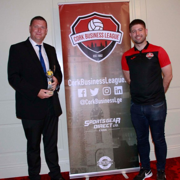 Darren O'Sullivan collects his Referee of the Year Award, alongside League Secretary Peter Travers