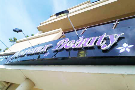 Shopfront sign with PVC raised letters