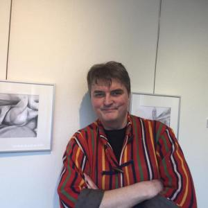 Corne Akkers posing at the opening of an exhibition