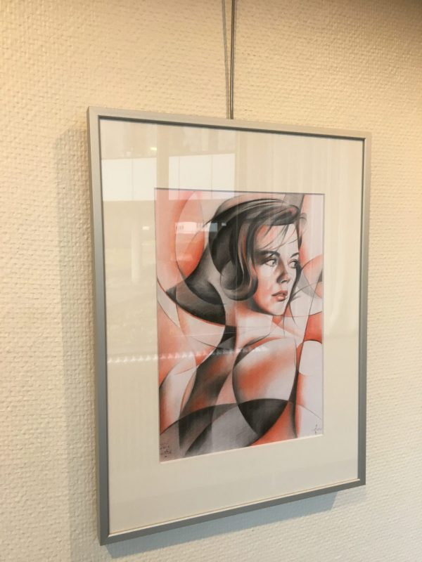 framing example of a cubistic portrait drawing of Natalie Wood in colored pencil