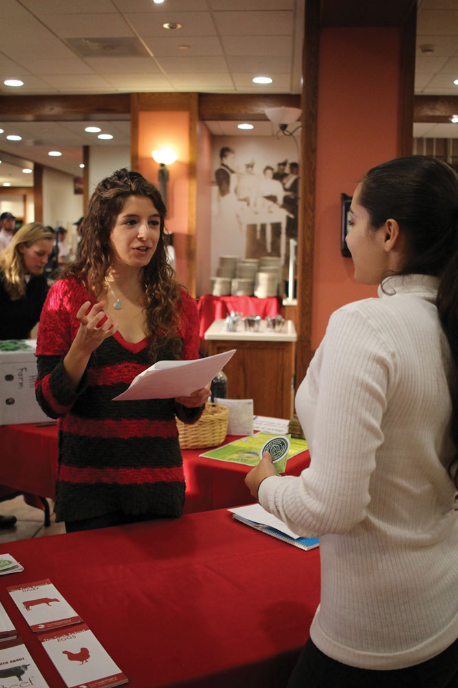 Students from Real Food Cornell inform Cornellians about a range of issues related to food production. (Darien Kim / Sun Staff Photographer)