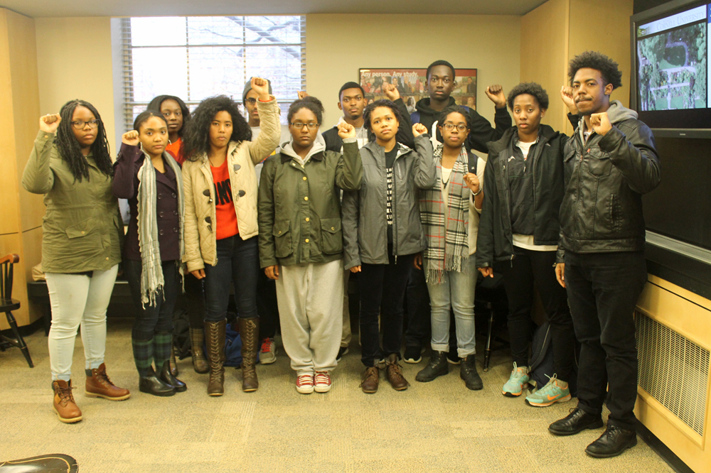 Cornell's Black Students United kicks off their movement for divestment from prison and mass incarceration-affiliated companies by dropping off a letter in President Elizabeth Garrett's office yesterday. (Michaela Brew / Sun Sports Photography Editor)