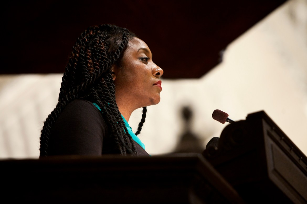 Alicia Garza speaks after she is presented with a public service award at Harvard Memorial Church in Massachusetts in October. (Kayana Szymczak/ The New York Times)