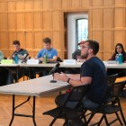 Students in the Cornell community and members of the S.A. debate the merits of establishing a College of Business in the Willard Straight Memorial Room Thursday.