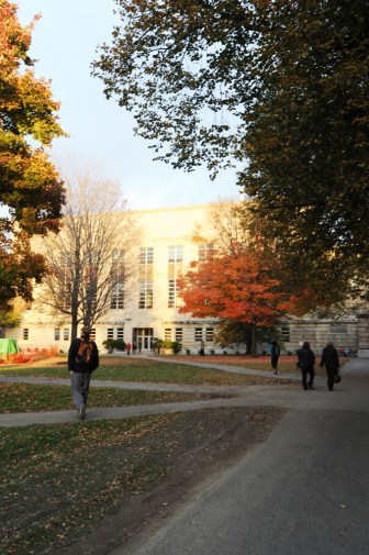 """The word """"Excelsior"""" — New York's official motto, meaning """"ever upward"""" — is inscribed above the entrance to Mann Library (pictured). The library serves two of Cornell's contract colleges — CALS and human ecology."""