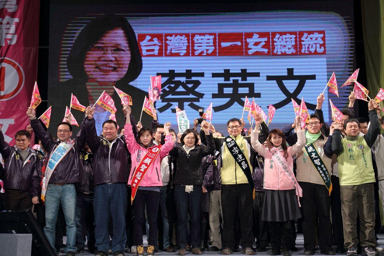 Tsai Ing-wen LLM '80 (center) attends a rally in Taipei on Dec. 25, 2011.