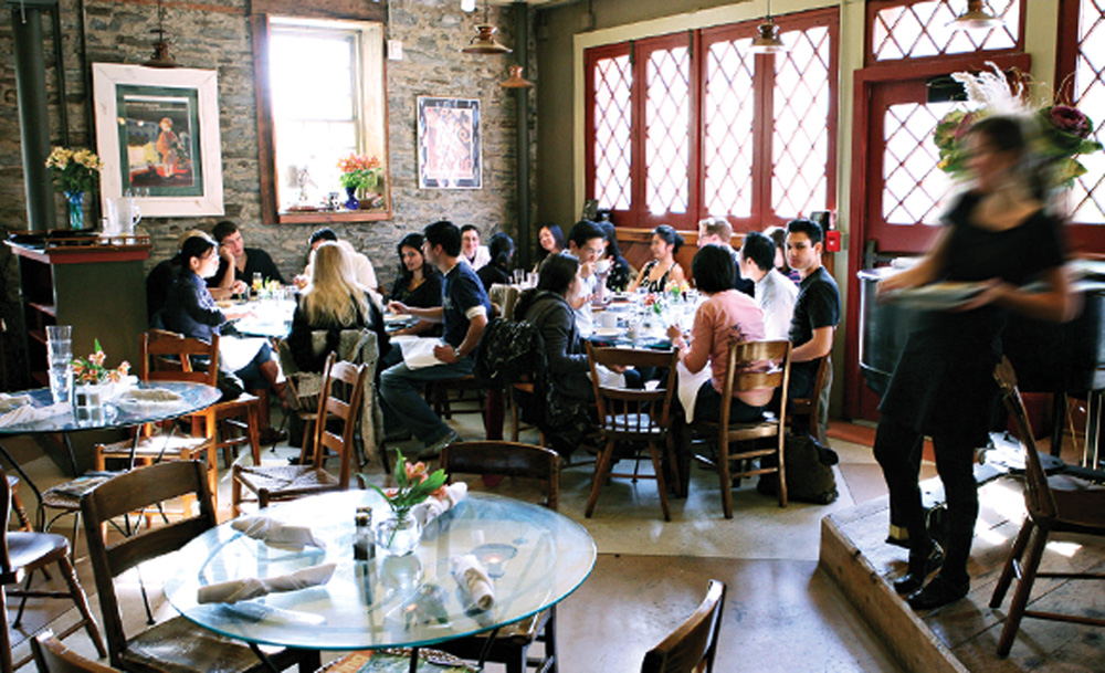 Students and locals enjoy brunch at Carriage House Café.