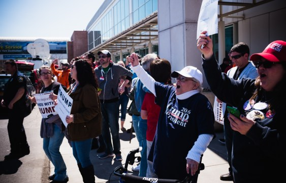 Trump fans shout across at protestors outside the Oncenter Saturday.
