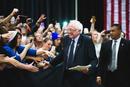 Bernie Sanders greets supporters as he walks to the podium at the Oncenter in Syracuse.