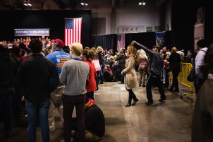 A couple dances while awaiting Bernie Sanders' arrival at a rally in Syracuse Tuesday.