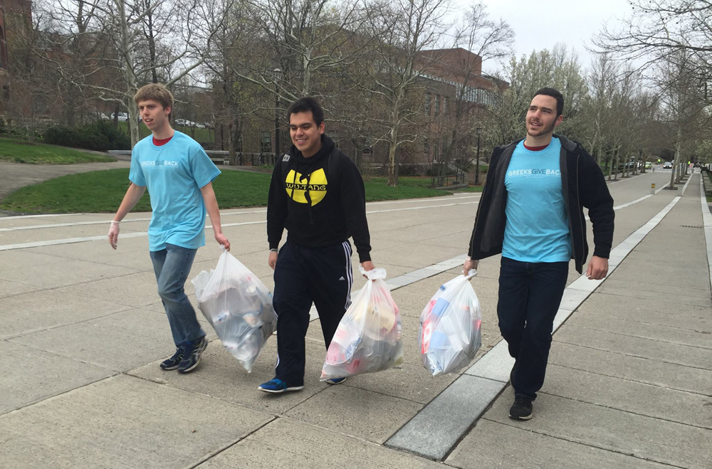 Fraternity members help clean up Cornell's campus at the 2016 Greeks Give Back event.