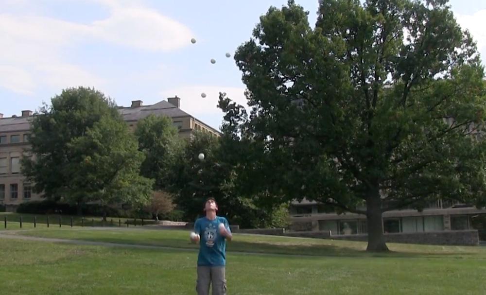 Matan Presberg '18 performs juggling tricks on the Arts Quad.