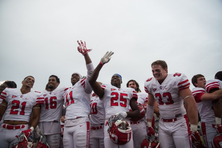 The men of Cornell football celebrate following their upset victory over No. 25 Colgate.
