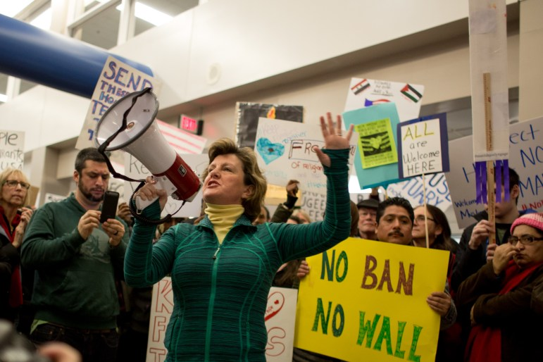 "Syracuse Mayor Stephanie Miner addressed the crowd Sunday night and said Syracuse is ""a city of immigrants."""