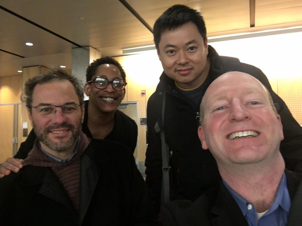 (From left to right) Attorneys David Whedbee, La Rond Baker, Andrew Chan, and Joe Shaeffer '92 inside the Seattle-Tacoma International Airport.