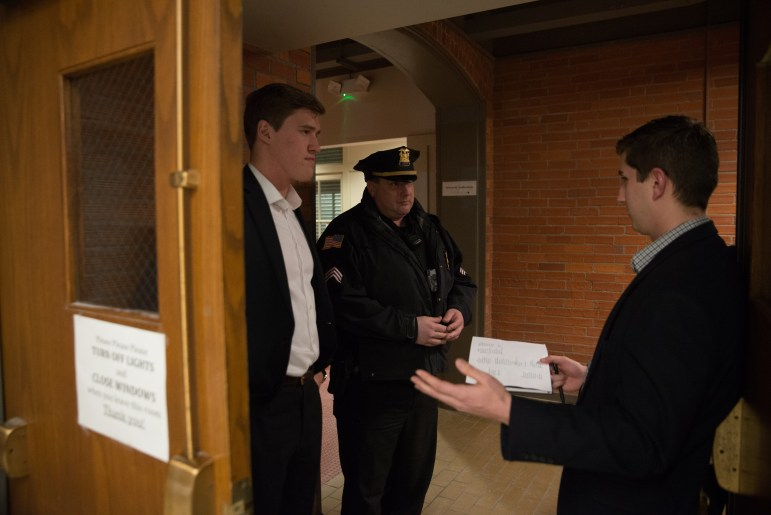 A Cornell Police officer stood outside of Michael Johns' lecture on Tuesday and monitored protests outside