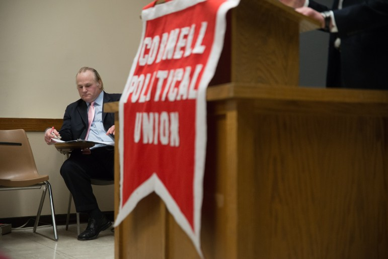 Michael Johns, leader of the Tea Party, waits to speak in Rockefeller Hall on Tuesday Evening.