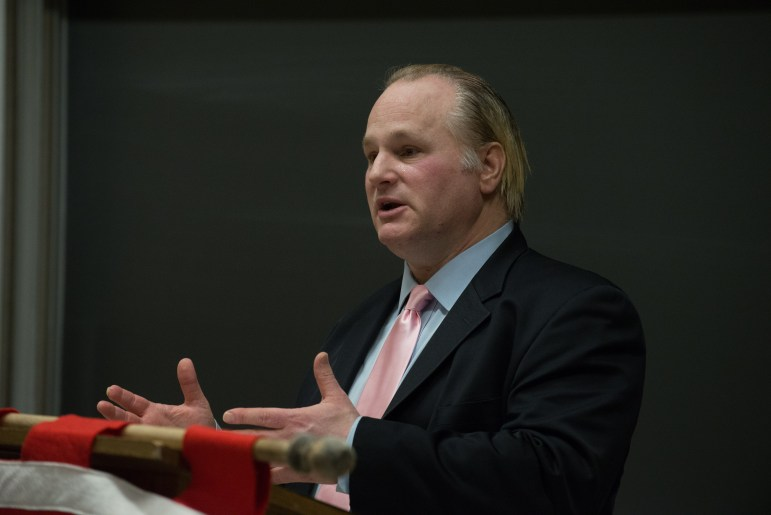 """Michael Johns, a Tea Party leader, spoke in Rockefeller Hall on Tuesday evening, saying there were """"ominous forces"""" at the U.S. border"""
