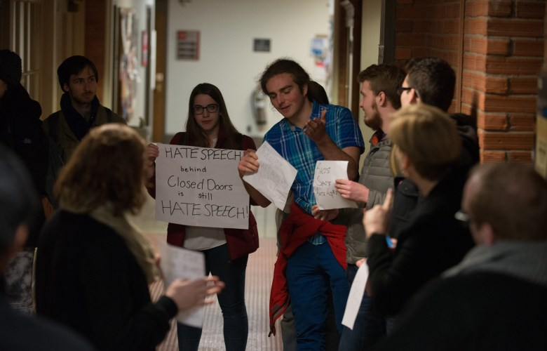 Students protest outside of Michael Johns' lecture on Tuesday.