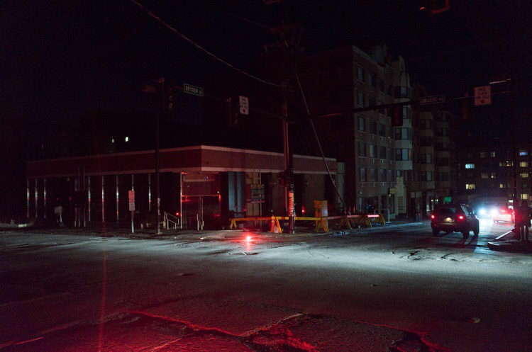 Emergency services set up flares around the intersection of Dryden Road and College Ave as traffic lights cut out during the power outage.