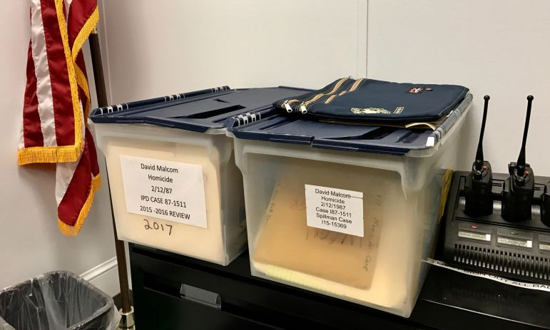 Two bins of notes related to the Malcom homicide investigation sit in Deputy Chief Vincent Monticello's office at the Ithaca Police Department