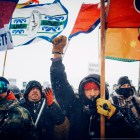 Military veterans and tribal leaders, despite heavy snow and winds, protest against the controversial Dakota Access Pipeline.