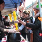 People enjoy Chili Fest on the Ithaca Commons a few blocks away from where Food Not Bombs gave out free vegetarian chili.