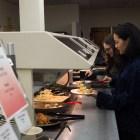 Mina Huh '20 gets food at Risley's Gluten-free Grand Reopening.