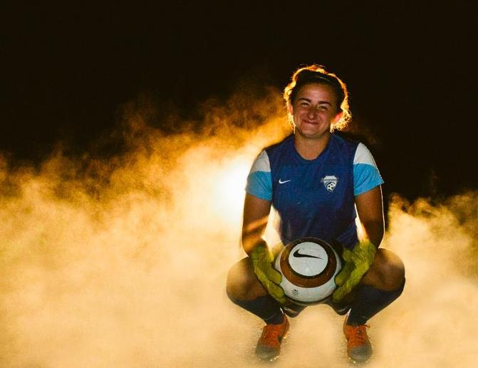 The first women's soccer player to turn pro has returned to her alma mater.