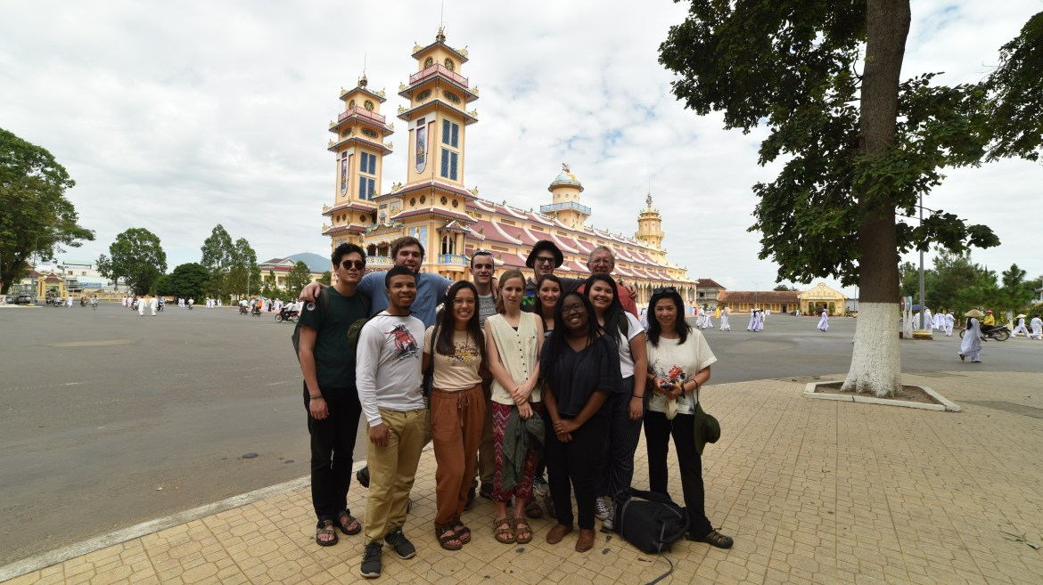Prof. Hoffman and Prof Tranviet with the students who participated in the program in the front of the Cao Dai Temple in Tay Ninh, Vietnam.