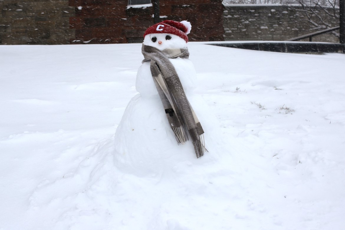 A snowman with Big Red spirit next to Uris Hall at Cornell on Tuesday, March 14, 2017.