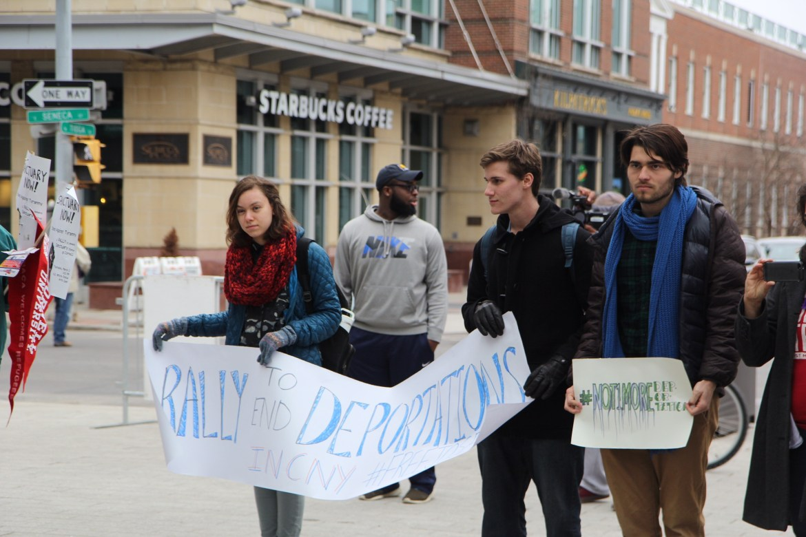 Ithaca community members gathered at a rally in the Commons on Thursday to stand in solidarity with migrant workers facing deportation.