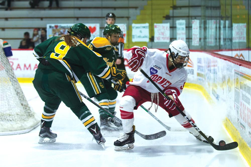 Pg-12-Womens-Hockey_-#9-Hanna-Bunton-senior-by-Cameron-Pollack-photo-editor