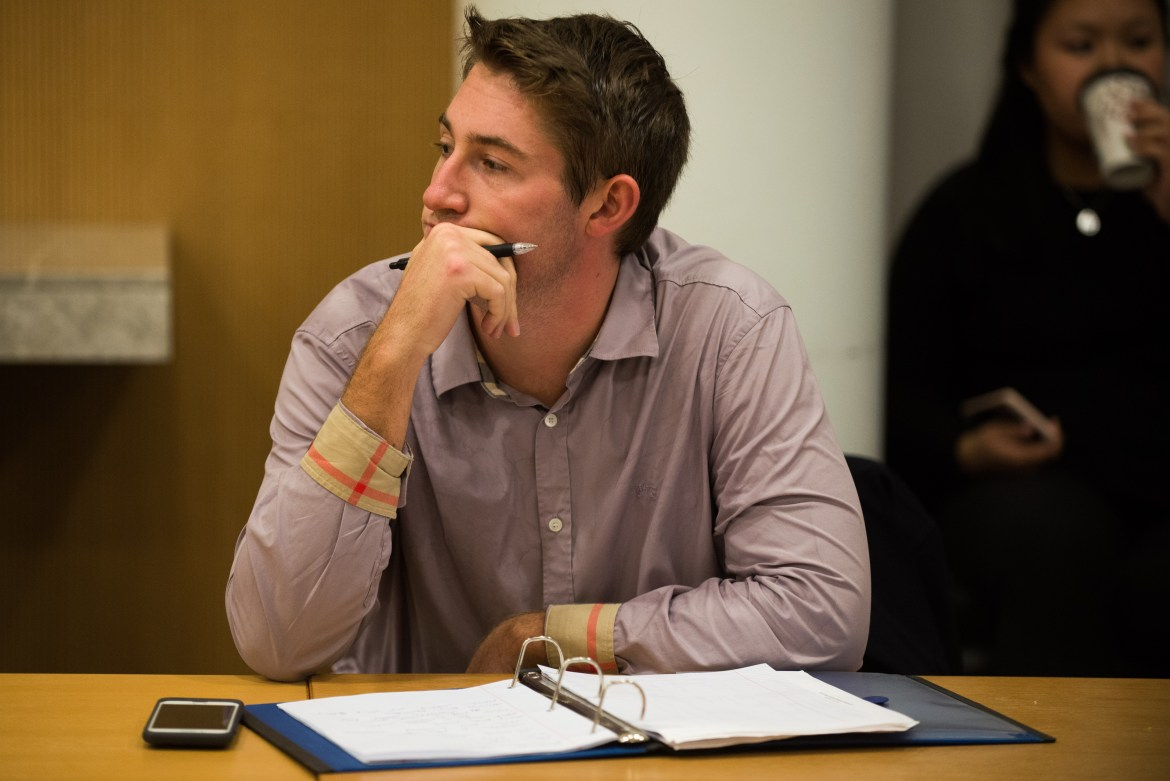 Several faculty members said they were troubled by Cornell's charges against Mitch McBride '17, pictured at a Feb. 28 University Assembly meeting, for sharing documents with The Sun.