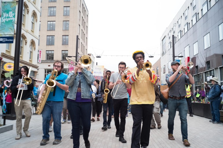 Demonstrators rallied at the Ithaca Commons and marched to The Space at Greenstar for the Climate March in recognition of Earth Day, 29 April.