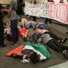 Members of Students for Justice in Palestine stage a die-in at a Cornell Hillel event celebrating Israel Independence Day on Monday