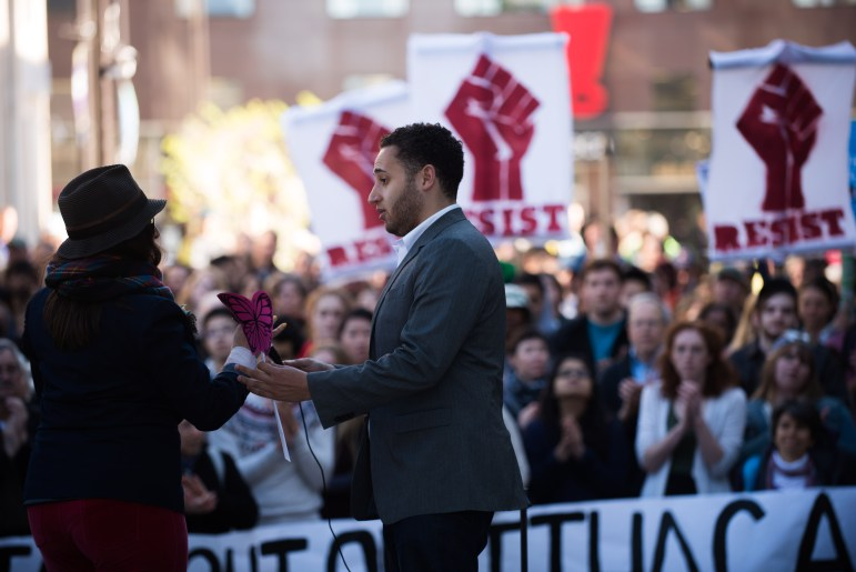 Ithaca Mayor Svante Myrick '09 stands beside Carolina Osorio Gil, director of ¡Cultura! Ithaca, at the May 3 protest of ICE's arrest of Guzman-Lopez.