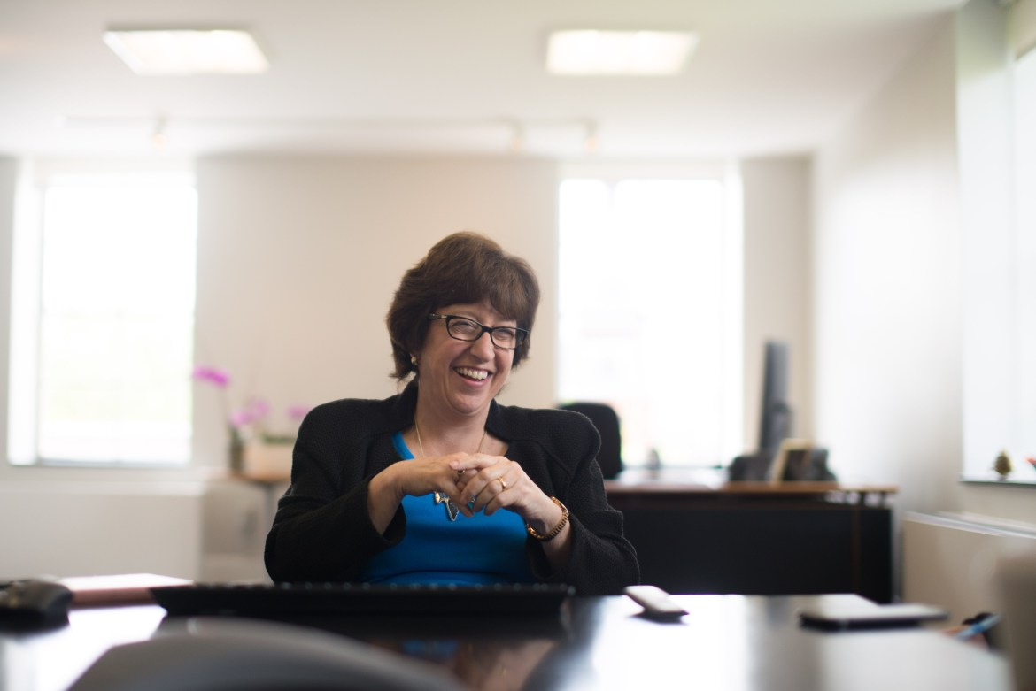 Cornell's 14th President Martha Pollack laughs in her office during an interview with The Sun on Monday.