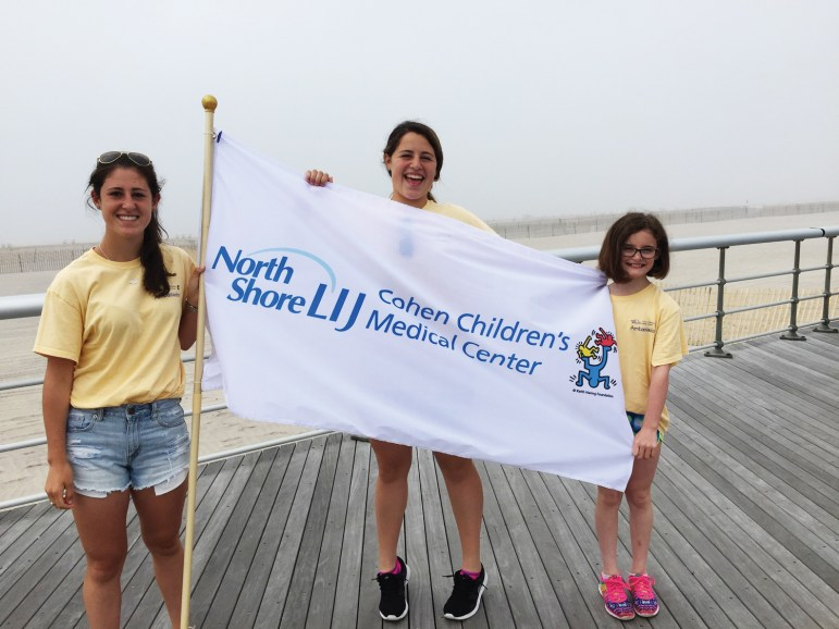 Maddy, with younger sisters Frankie and Kate, serving as an ambassador of the Cohen Children's Medical Center.