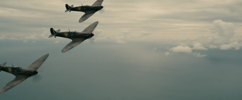 Dunkirk: Three Spitfire fighter jets flying over the English Channel.
