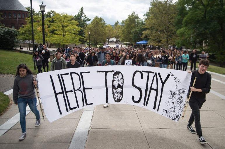Students and community members march up Ho Plaza at the Cornell DREAM Team's protest against the recision of the Deferred Action for Childhood Arrivals program earlier this week, September 8th, 2017. (Cameron Pollack / Sun Photography Editor)