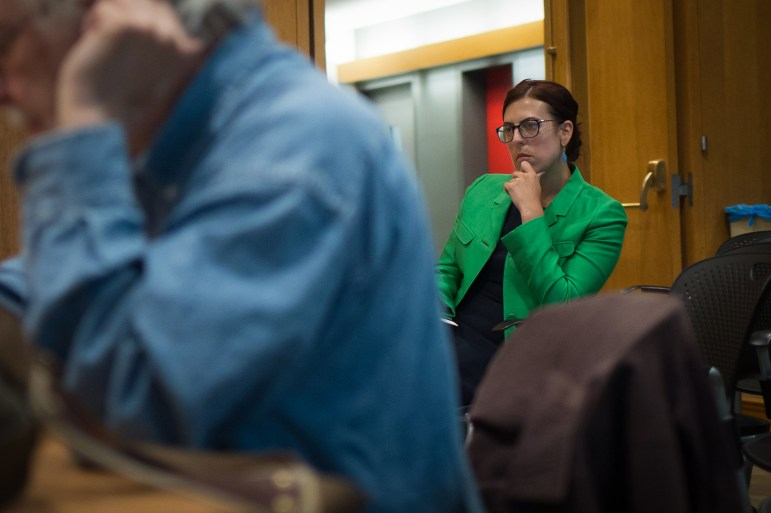 Michelle R. Horvath, Cornell's Judicial Administrator, listens to deliberations at the UA Meeting in 701 Clark Hall, September 5th, 2017. (Cameron Pollack / Sun Photography Editor)